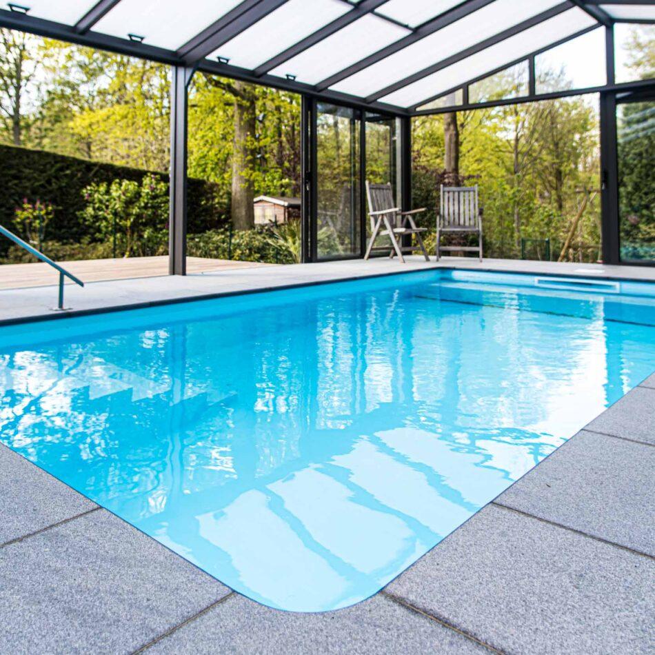 Construction piscine véranda